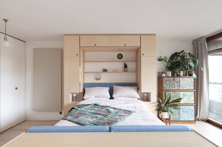 The Murphy bed folds down with ease and there are little slots on either side that become nightstands