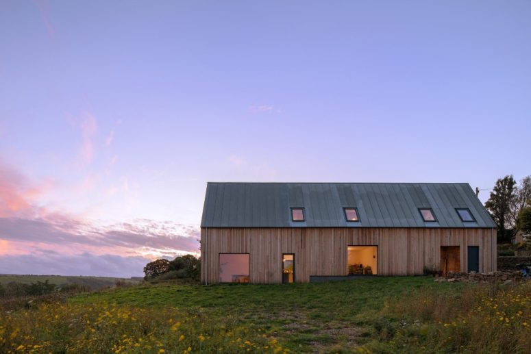 The house is clad with Douglas fir and a zinc roof, there are lots of windows and skylights