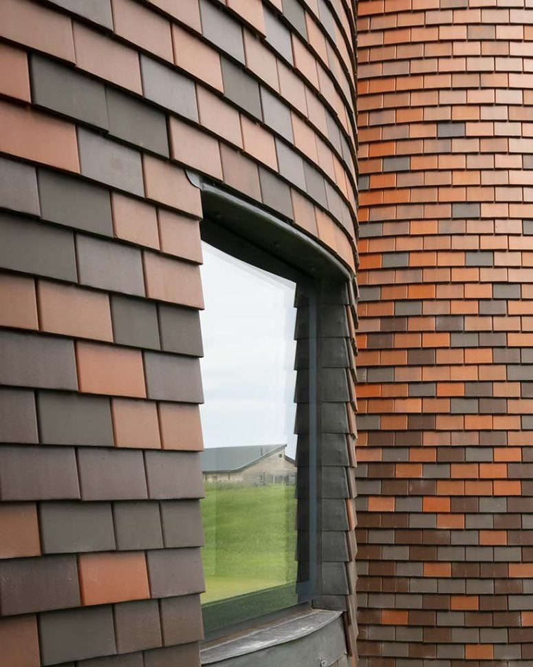 The house is clad with traditional shingle tiles