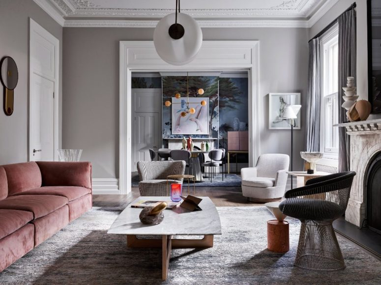 The muted color palette is spruced up with bold artworks, lamps and accessories
