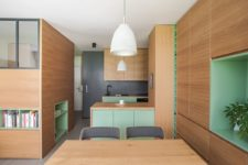 02 The whole apartment is done in light-colored oak, with touches of bright green