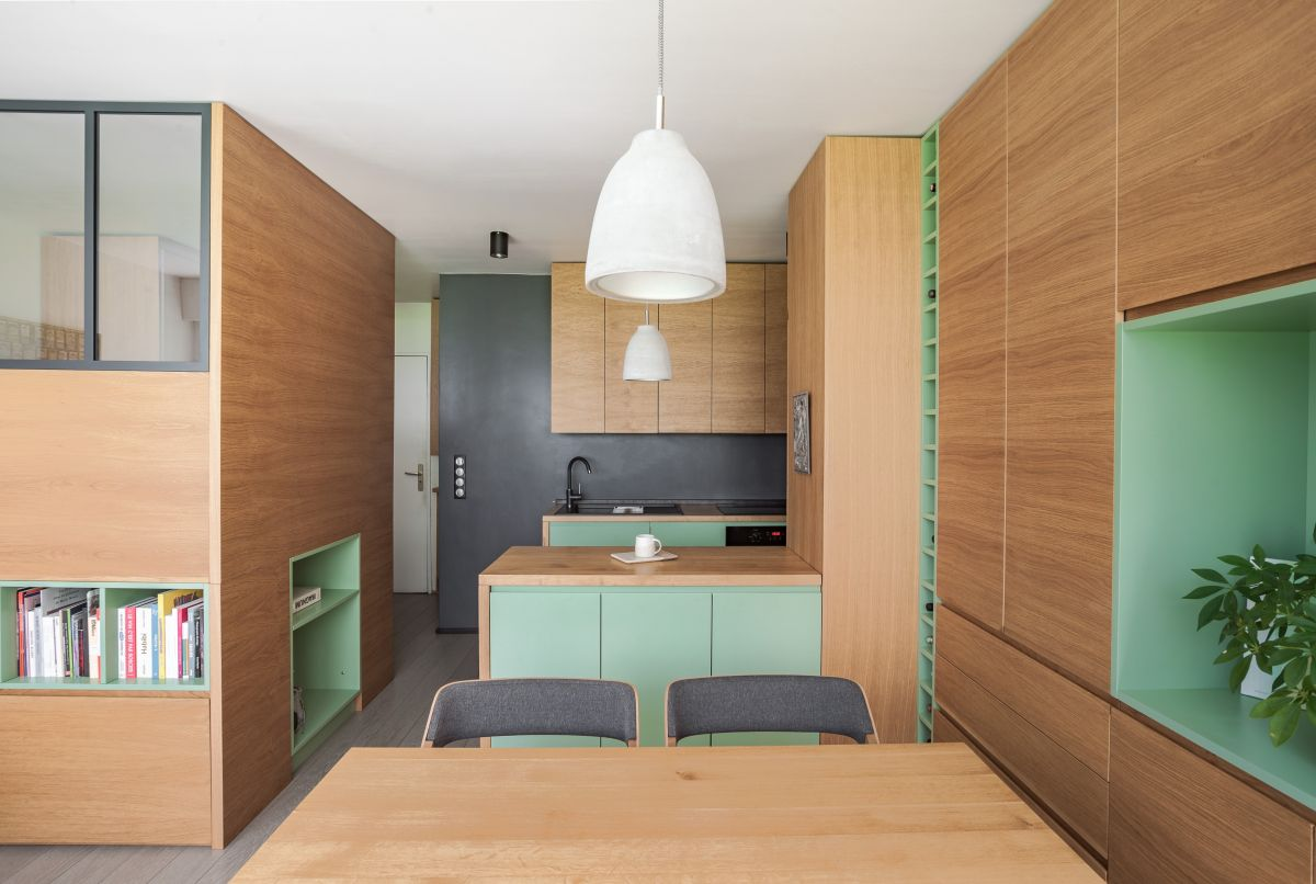 The whole apartment is done in light colored oak, with touches of bright green