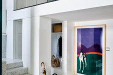 02 These are two apartments merged into one, filled with natural light and with bold artworks and trendy furniture