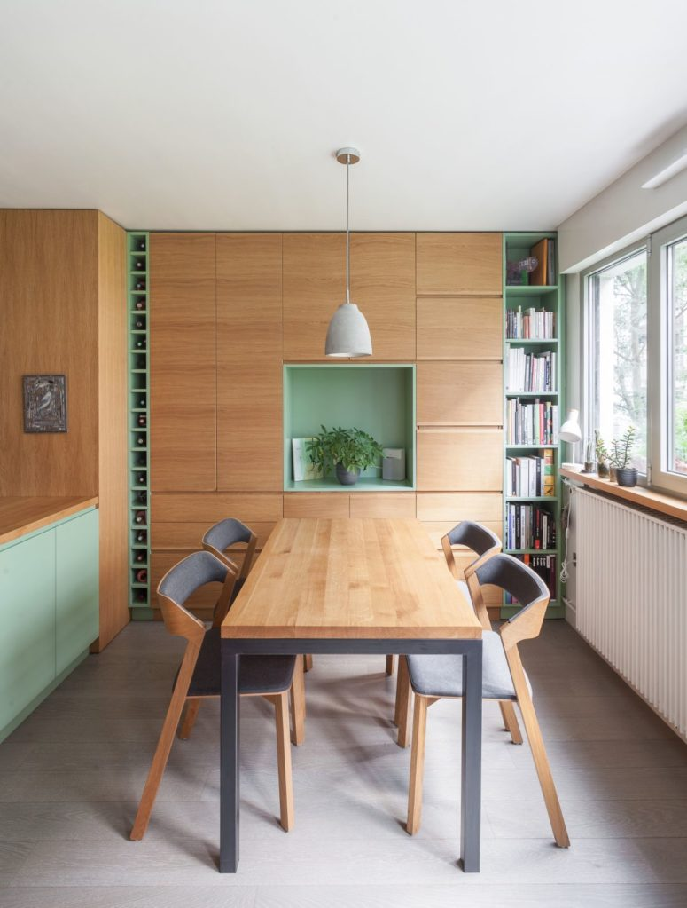 The dining zone is done with a contemporary set, with a built-in storage unit and shelves