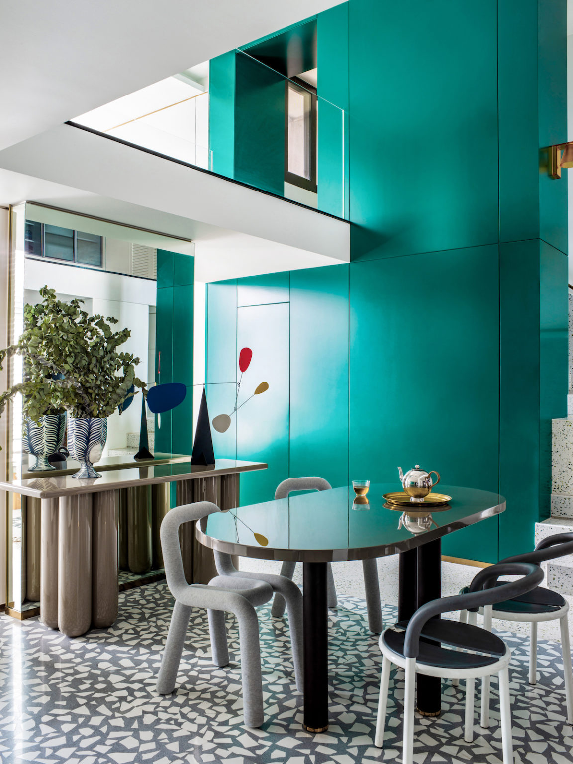 The dining space is innovative due to the pieces that are used to furnish it   these are bold ones