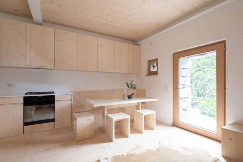The indoor spaces are done with light colored wood for a maximally natural look