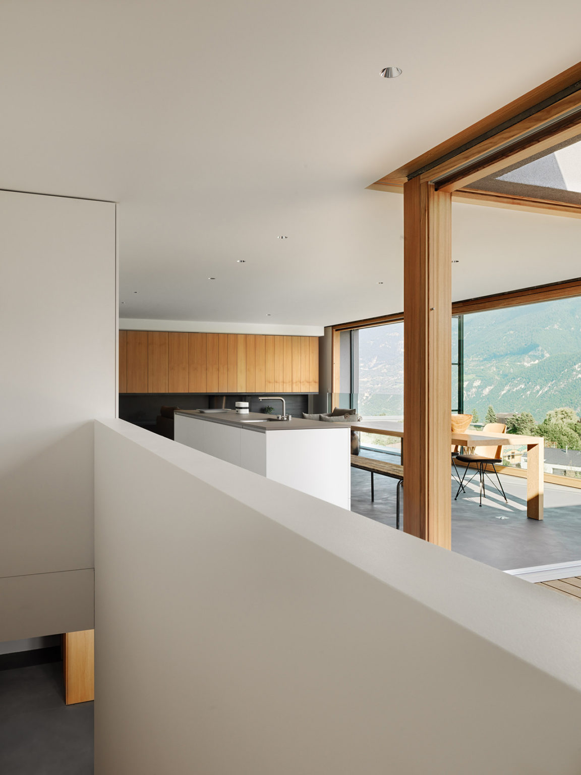 The interiors are done in minimalist style continuing the exterior aesthetics and the decor is very simple and laconic