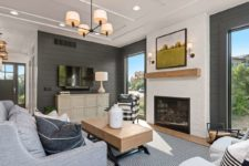 04 The living room is clad with bricks and shiplap, there's a fireplace and cool views
