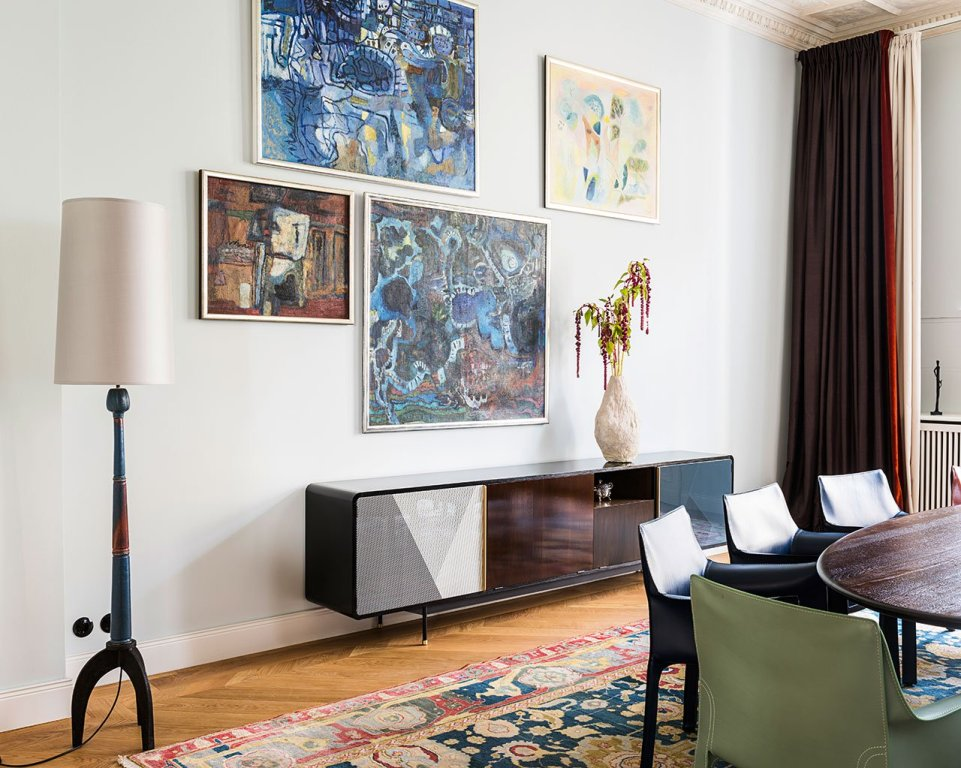 The spaces were brightened up with gorgoeus artworks, the chic mid century furniture fits perfectly