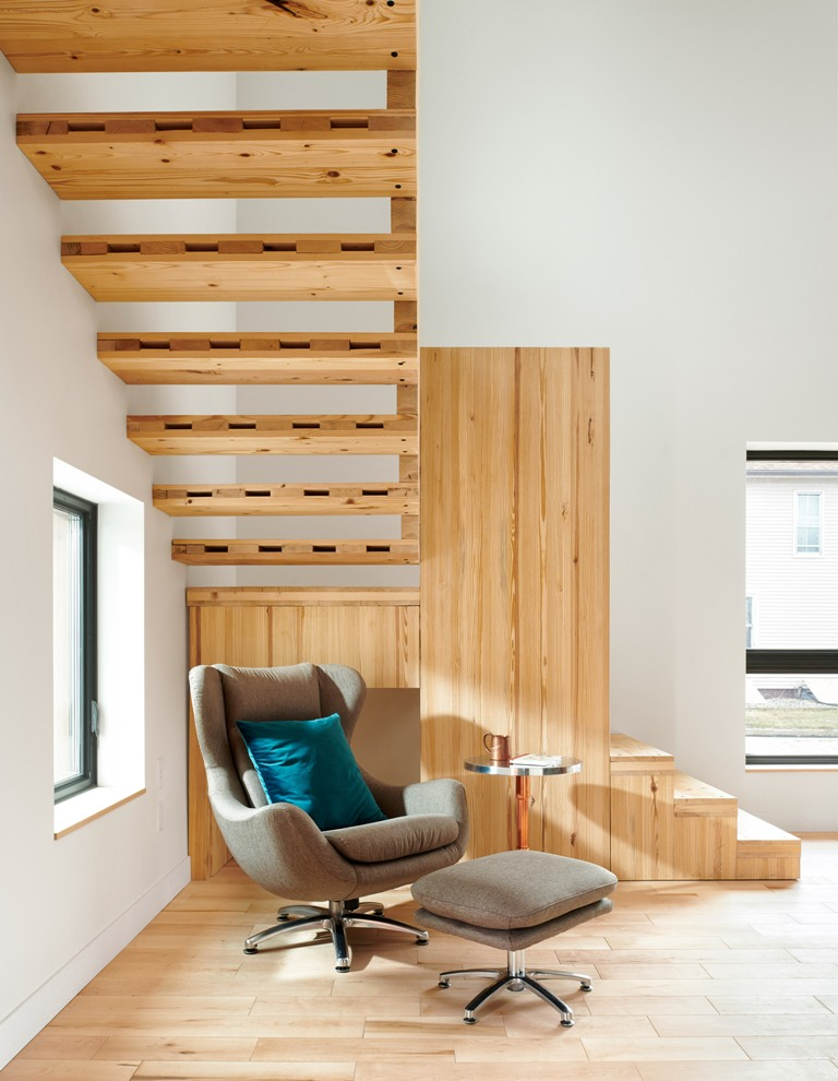 The under the stairs space was taken by a cozy reading nook with a comfy chair and footrest