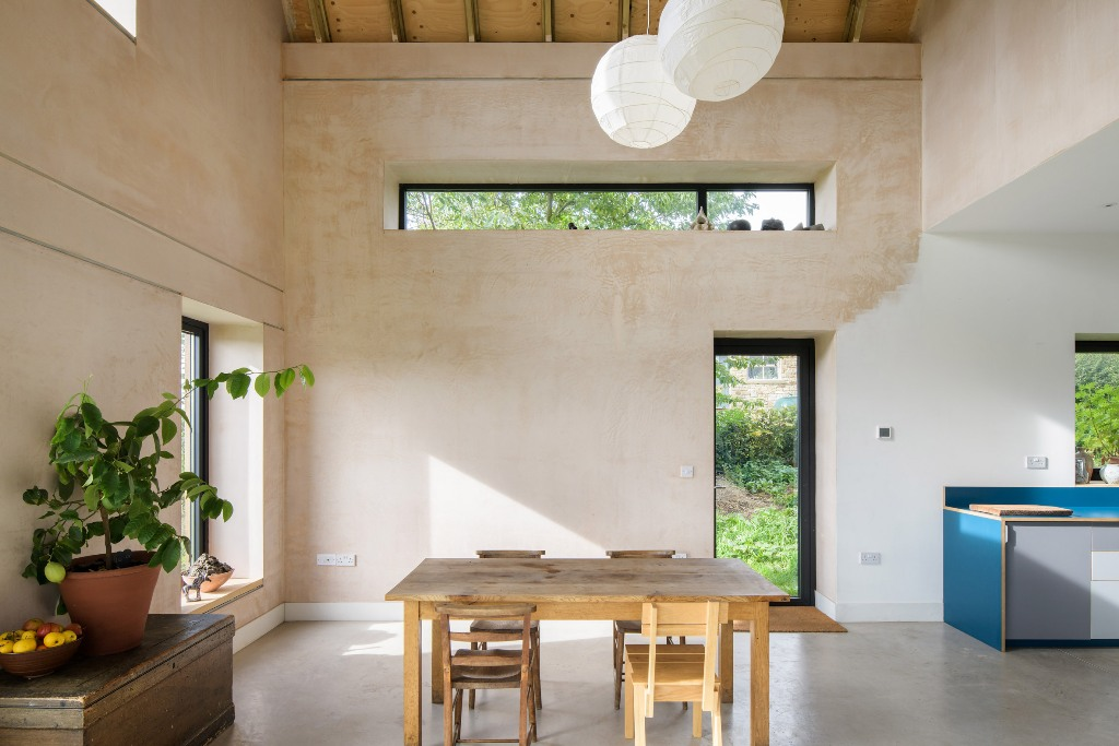You can alo see brown plaster that was used to warm up the space, and lots of natural light floods the spaces