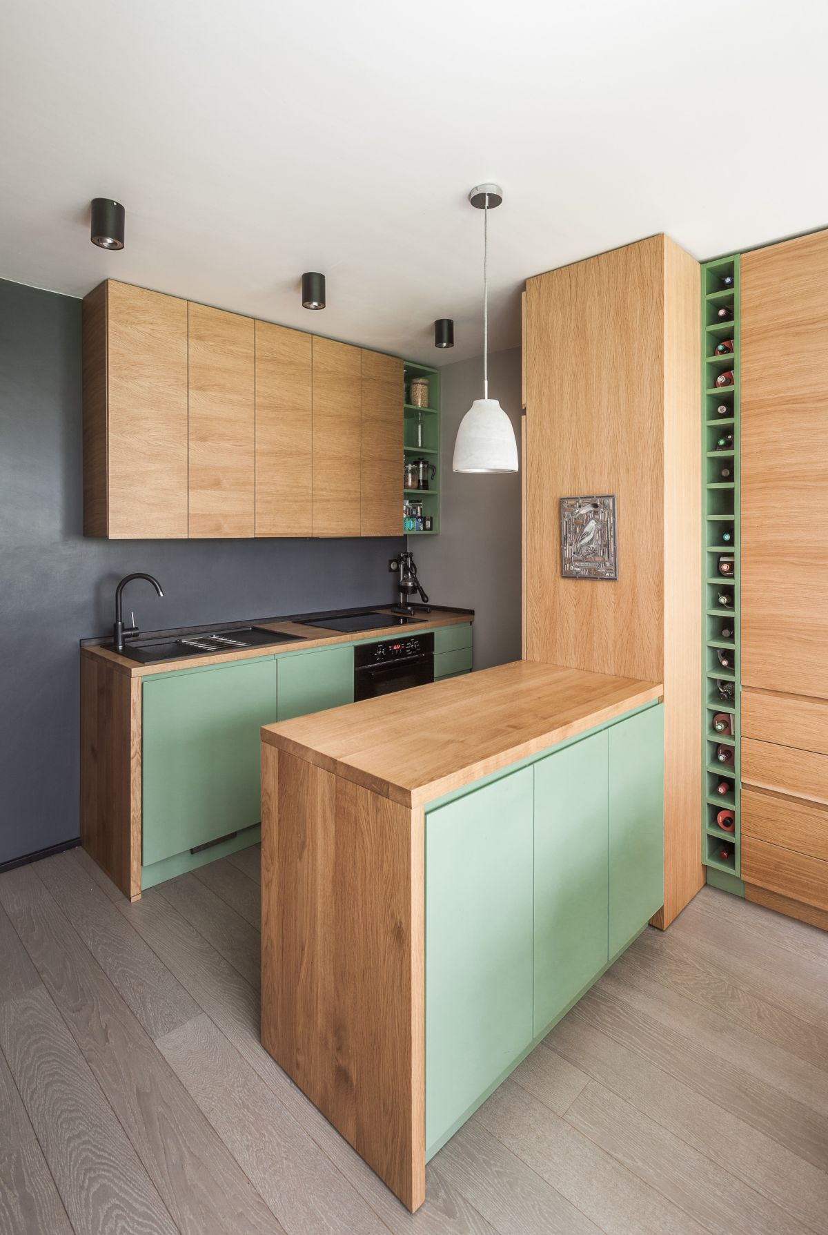 The kitchen features light colored cabinets and minty green doors   everything necessary is here