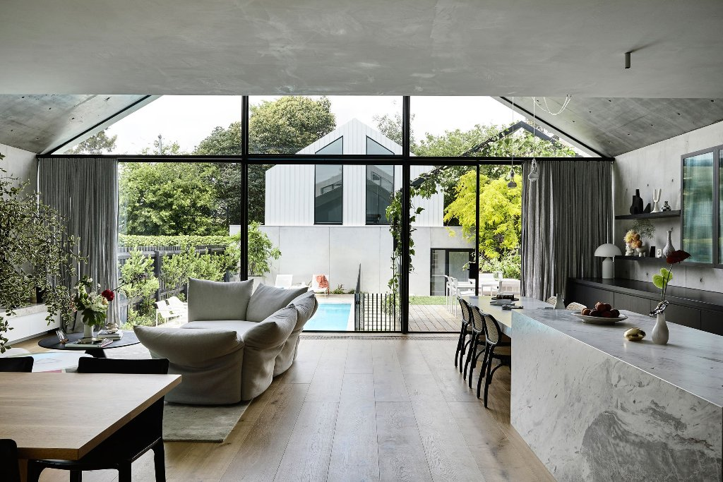 This space features a glass wall that connects it to outdoors