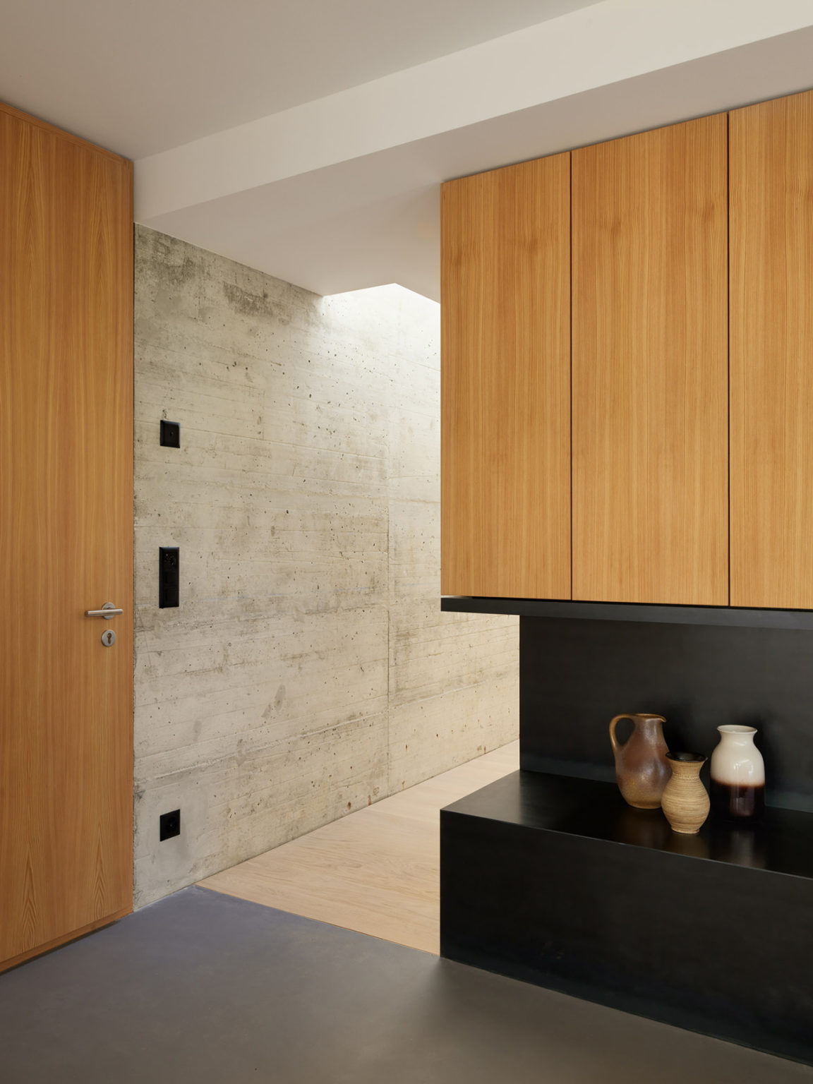 Concrete that was used for exterior decor is also used insidde and that ties the spaces