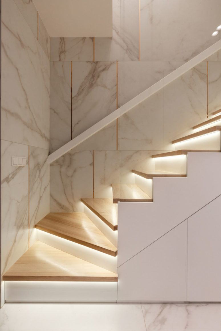 The staircase is very chic, done in white with additional lights