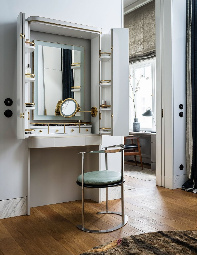 There's a gorgeous and functional makeup nook that can be hidden
