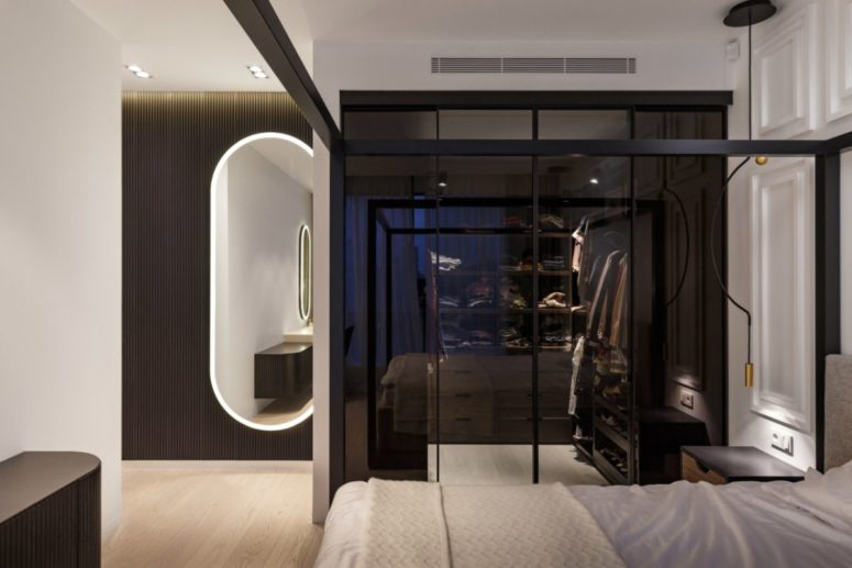 The master bedroom contains a small glass enclosed closet inside