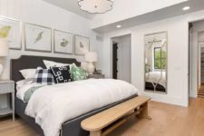 09 The master bedroom is very welcoming and cozy, with cool artworks and an upholstered bed