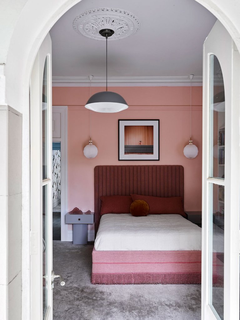 One more bedroom is filled with pink and burgundy and accented with mid-century modern touches