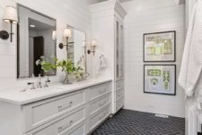 10 The master bathroom is done with white shiplap and a grey tile floor
