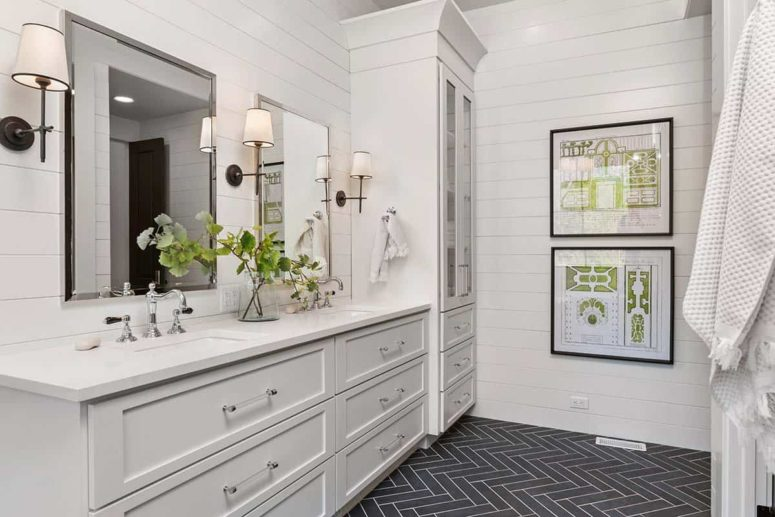 The master bathroom is done with white shiplap and a grey tile floor