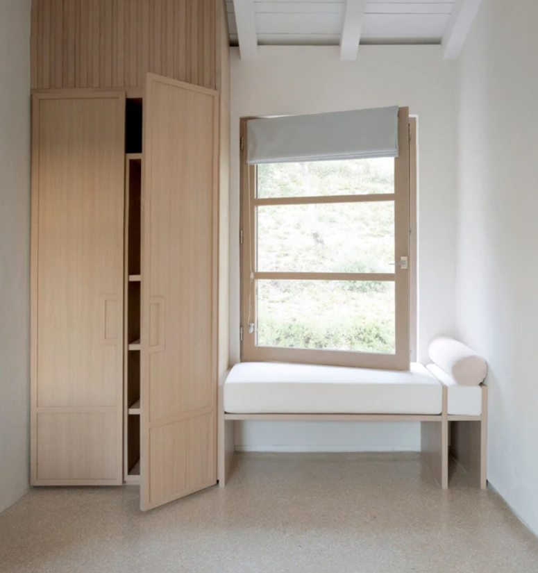 The storage units are simple and sleek, there's a cool window seat with shades, a perfect nook to read