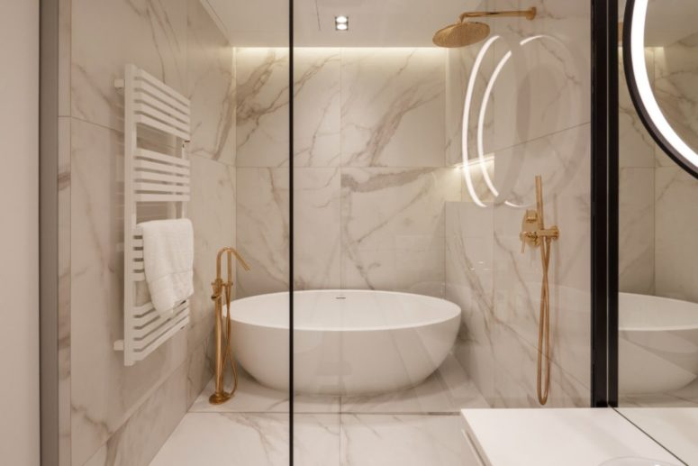 The master bathroom is clad with white marble and has an elegant shower and tub combo