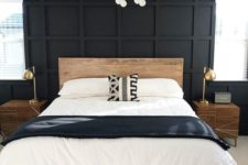 a black statement panel wall makes this neutral bedroom look bold, cool and unusual taking over the space