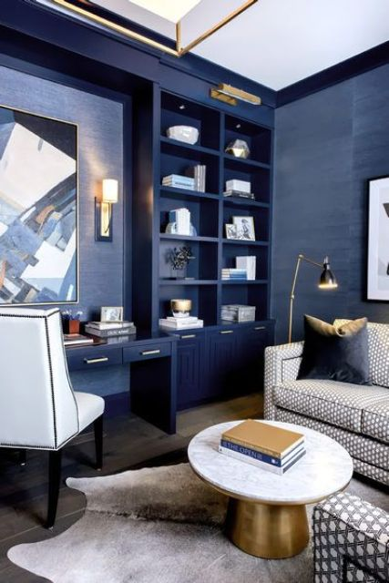 a bright home office done in bold blue, with elegant gold touches and some whites to refresh the space