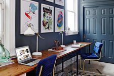 a stylish home office with nice blue walls