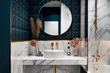 a chic bathroom with white marble and teal tiles, with gold accents and edges here and there for a refined touch