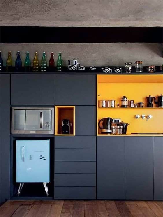 a functional super stylish kitchen design in black and yellow
