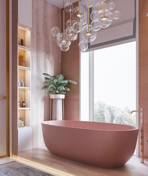 a cool bathroom with pink plywood walls, a pink tub, lit up built-in shelves and lots of bubble lights over the bathtub