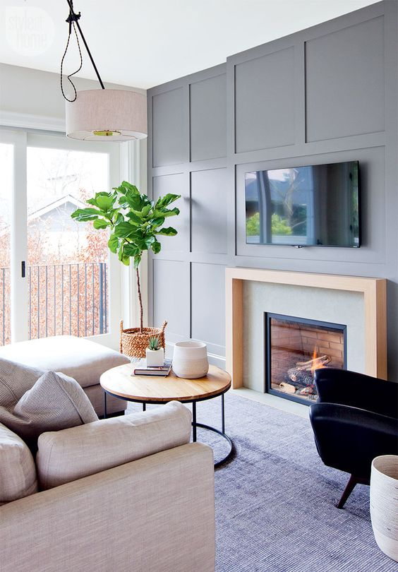 a grey wall won't be boring if you go for some paneling like here and maybe build in a fireplace for a chic look