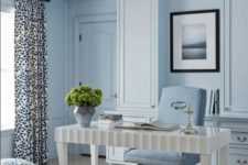 a light blue home office with a refined white desk, a powder blue chair, printed textiles and some greenery to refresh