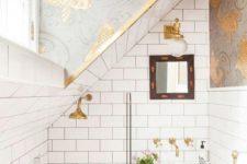 a cute gold-white tiny bathroom design