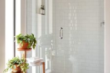 a small but bright bathroom design in white