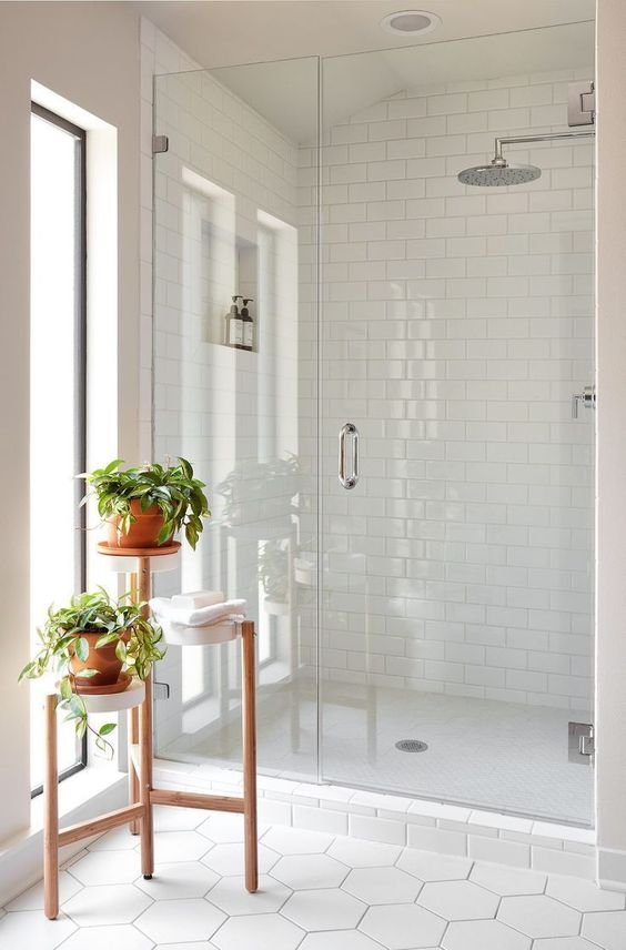a small but bright bathroom design in white