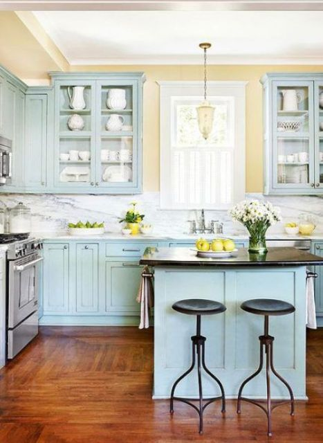 a tender pastel kitchen done in light blue and yellow, with touches of black and white for a bolder look