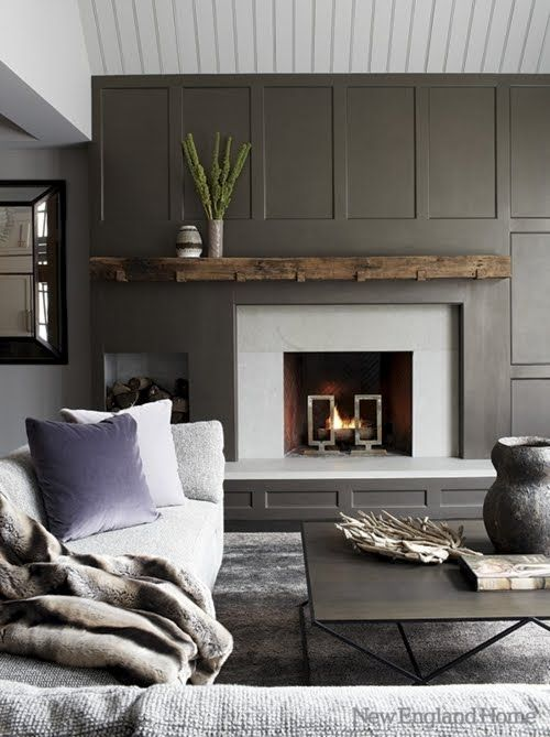 a welcoming modern living room with a grey paneled statement wall and a fireplace that stands out a lot
