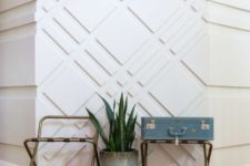 an ultra-modern entryway with white paneled walls that look catchy, add pattern and texture to the space