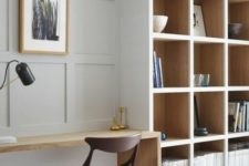 make a usual neutral wall chic and catchy with paneling like here and it will echo with built-in shelves