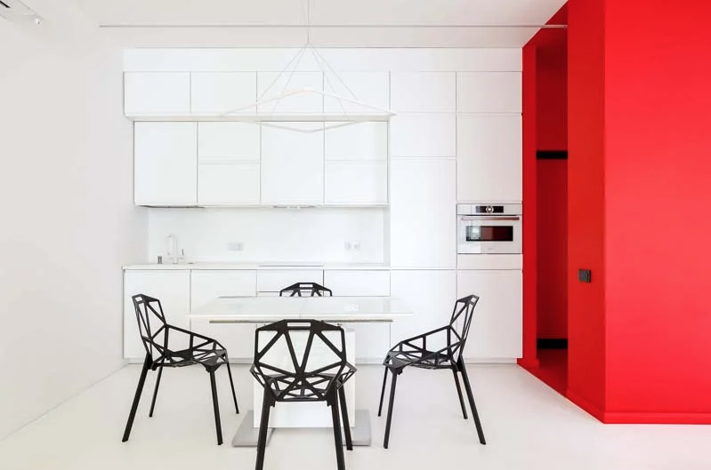 This bright and ultra modern apartment is characterized with bright splashes of color here and there and looks super bold