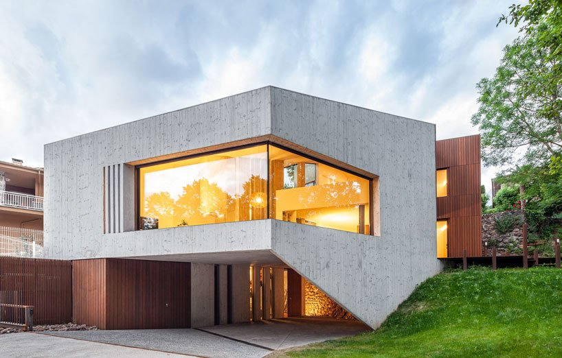 This chic contemporary home is built into a sloped site to establish a relationship with nature