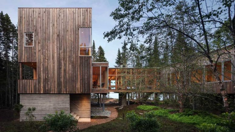 This contemporary treehouse inspired cabin is built on stilts and features a U shape and a central courtyard