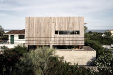01 This holiday home of wood and concrete was built by an architect and decorated by his wife, a designer