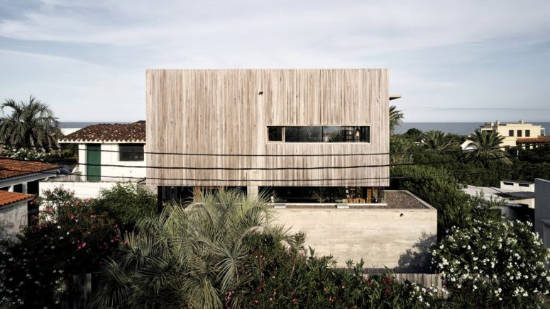 Holiday Home Of Weathered Wood And Concrete