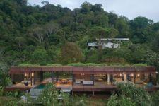 01 This jungle villa features an industrail facade and luxurious interiors plus cool natural views