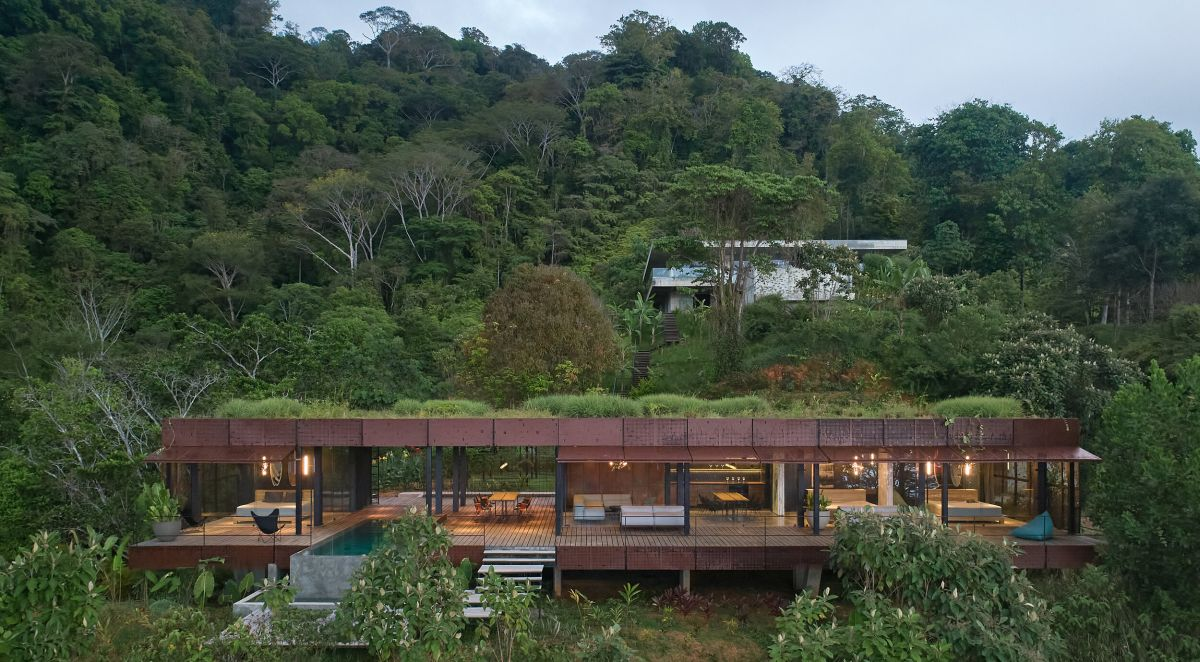 This jungle villa features an industrail facade and luxurious interiors plus cool natural views