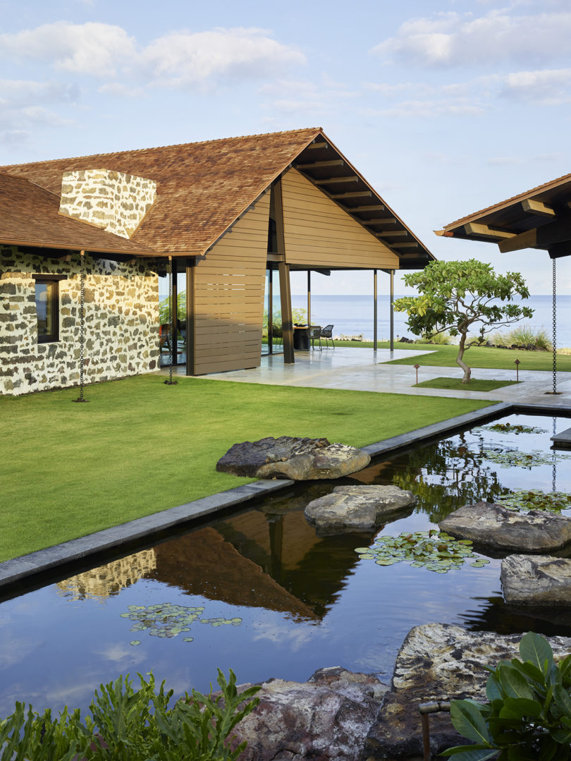 This modern home in Hawaii sits on a hardened lava field and overlooks the seaside